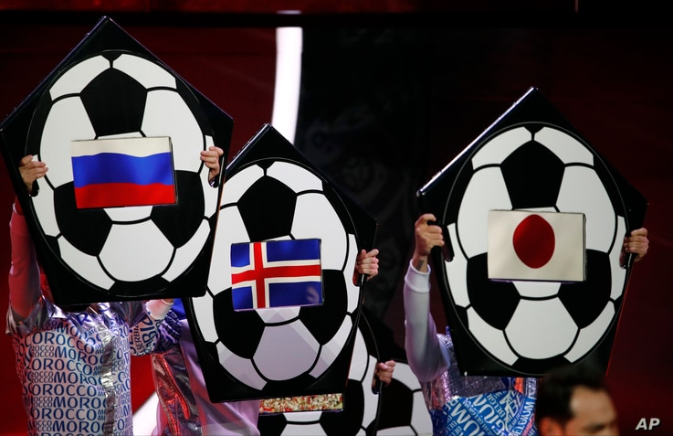 The flags of Russia, Iceland and Japan are held up on placards during the 2018 soccer World Cup draw in the Kremlin in Moscow, Dec. 1, 2017.