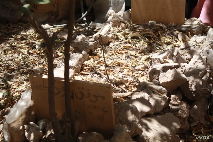 The body of a man buried in this Old Mosul garden after he was shot dead by IS for smoking, taken on June 25, 2017 in Mosul, Iraq.