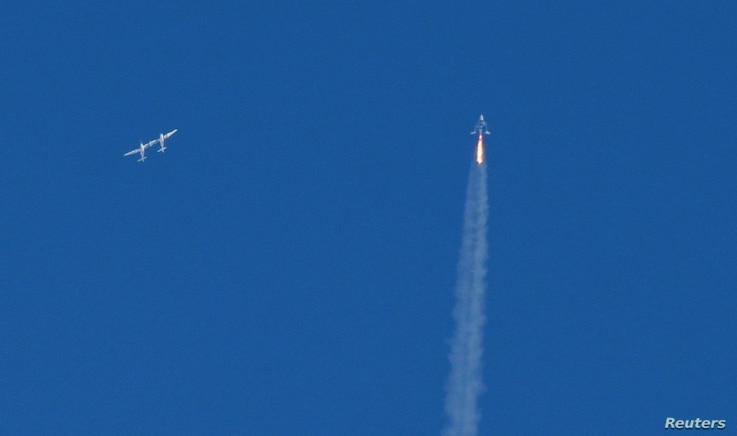 The SpaceShipTwo passenger craft moves away from the WhiteKnightTwo carrier airplane in Mojave, California, Feb. 22, 2019.