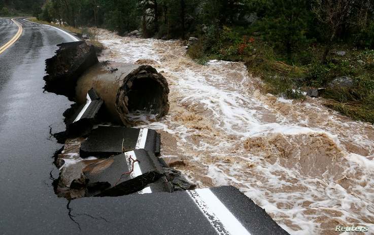 A section of Highway 72 is missing after a flash flood tore through Coal Creek near Golden, Colorado September 12, 2013. Flooding in Colorado left two people dead, prompted hundreds to be evacuated, caused building collapses and stranded cars, offici