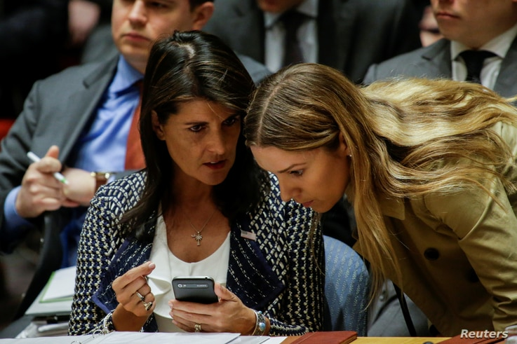 United States Ambassador to the United Nations Nikki Haley talks with one of her delegation members during the United Nations Security Council meeting on Syria at the U.N. headquarters in New York, April 13, 2018.