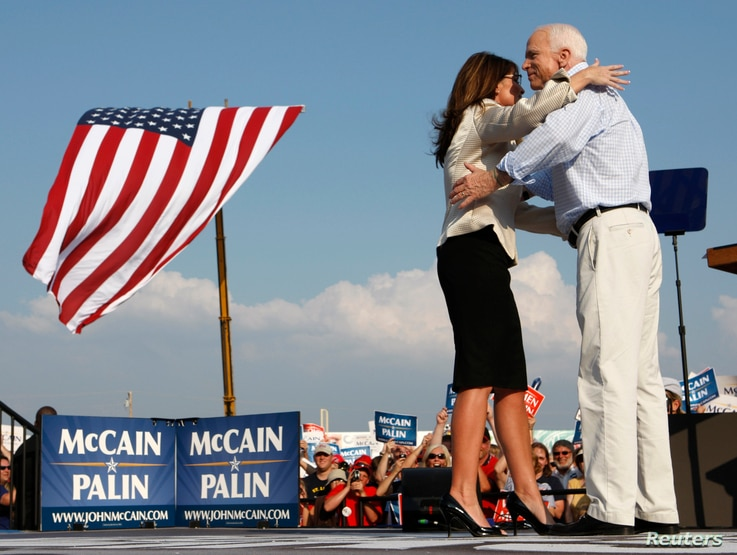US Republican presidential candidate Senator John McCain (R-AZ) and his running mate Alaska Governor Sarah Palin hug during a campaign stop in O'Fallon, Missouri August 31, 2008.