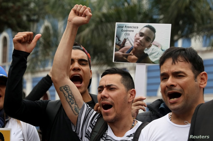 Demonstrators protest against Venezuela's President Nicolas Maduro's government during a meeting of foreign ministers and representatives from across the Americas to discuss issues related to the Venezuelan crisis in Lima, Peru. Aug. 8, 2017.