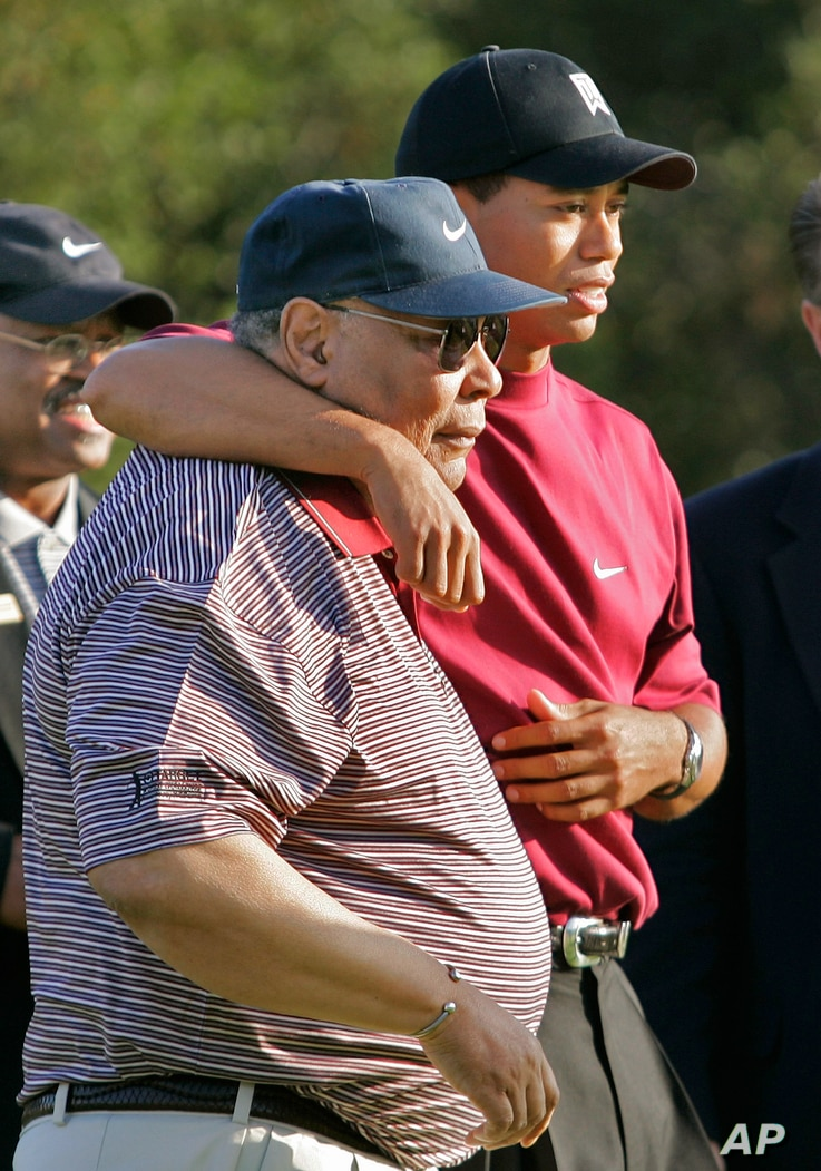 This Dec. 12, 2004 file photo shows Tiger Woods, right, hugging his father, Earl, after winning the Target World Challenge in Thousand Oaks, Calif. After Tiger Woods' Masters victory in 1997, there was widespread speculation that his rise to prominen...