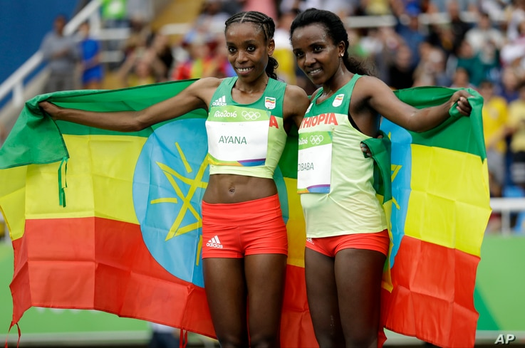 Ethiopia's gold medal winner Almaz Ayana, left, and Ethiopia's bronze medal winner Tirunesh Dibaba celebrate after the women's 10,000-meter final during the Summer Olympics in Rio de Janeiro, Brazil, Aug. 12, 2016.