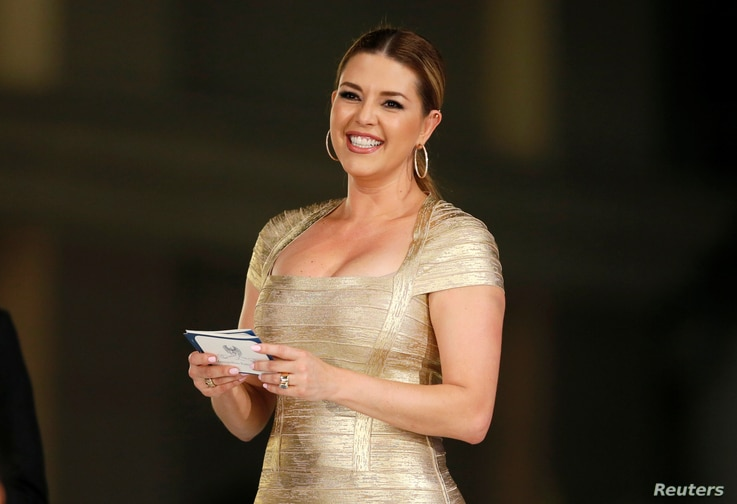Venezuelan-born former Miss Universe Alicia Machado, who was the subject of criticism over Twitter by Republican presidential candidate Donald Trump, presents an award at the Metropolitan Fashion Week's Closing Gala & Awards Show at Warner Brothers S...