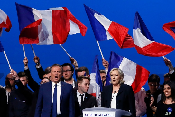 "French conservative candidate from the first-round election Nicolas Dupont-Aignan, left, and french far-right presidential candidate Marine Le Pen sing the ""Marseillaise"", the French national anthem at the end of their meeting, May 1, 2017, in Villep..."