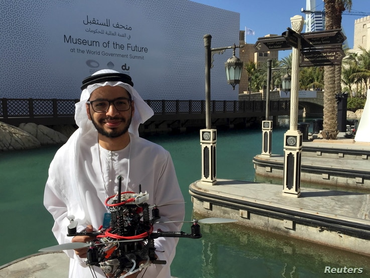 """Emirati Ph.D student Talib alHinai poses with the drone prototype he and his classmates at Imperial College London built, which won a prize at state-sponsored """"Drones for Good"""" competition, in Dubai, UAE, Feb. 10, 2016."""