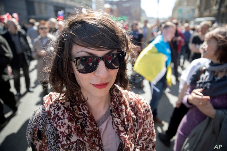 Protestor Nina Bereznyak attends an opposition rally in downtown Moscow, May 6, 2017, the anniversary of an opposition rally in  2012 that ended in violent clashes between demonstrators and police.