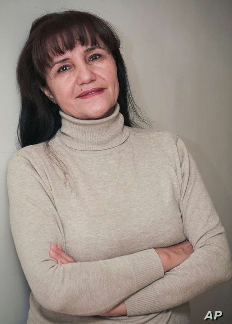 """FILE - Uzbek film director Umida Akhmedova, pictured in Tashkent in November 2009, is seen in Tashkent, has been accused of slander and """"damaging the country's image"""" for publishing a series of photos about life in rural parts of Uzbekistan."""