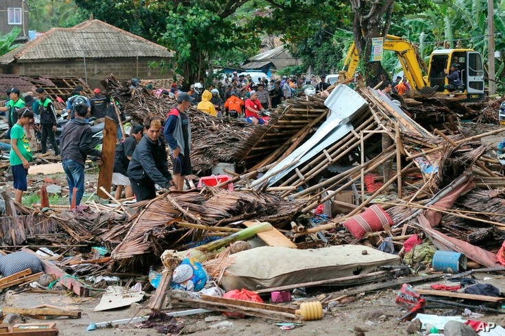 Residents inspect a house damaged by a tsunami, in Carita, Indonesia, Dec. 23, 2018.