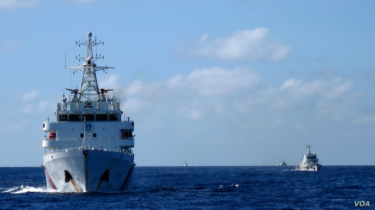 Chinese coastguard ships give chase to Vietnamese coastguard vessels (not pictured) after they came within 10 nautical miles of the Haiyang Shiyou 981, known in Vietnam as HD-981, oil rig in the South China Sea, July 15, 2014.