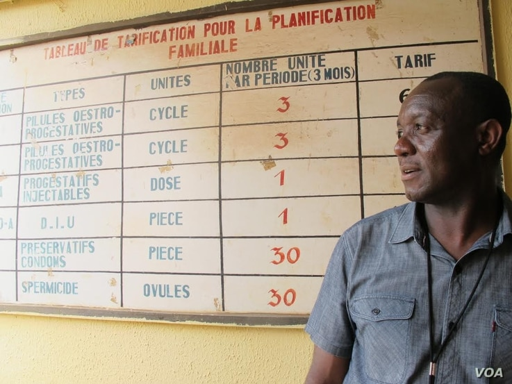 CDC epidemiologist John Ngulefac visits a community health center in Conakry, Guinea, while seeking clues about Ebola's spread.