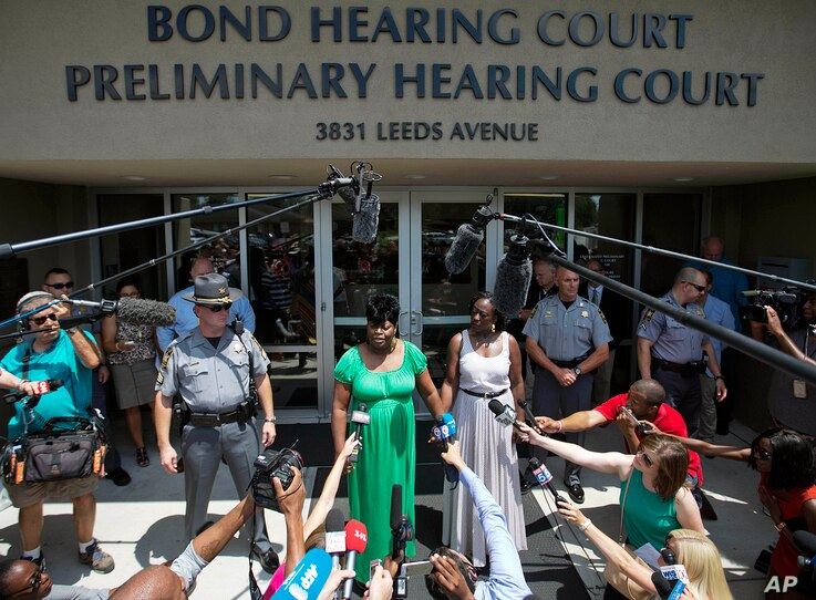 Nadine Collier, left, the daughter of Ethel Lance, one of the nine people killed in Wednesday's shooting at Emanuel AME Church, speaks to the media about her mother following the bond hearing for the suspected gunman, in North Charleston, S.C., June ...