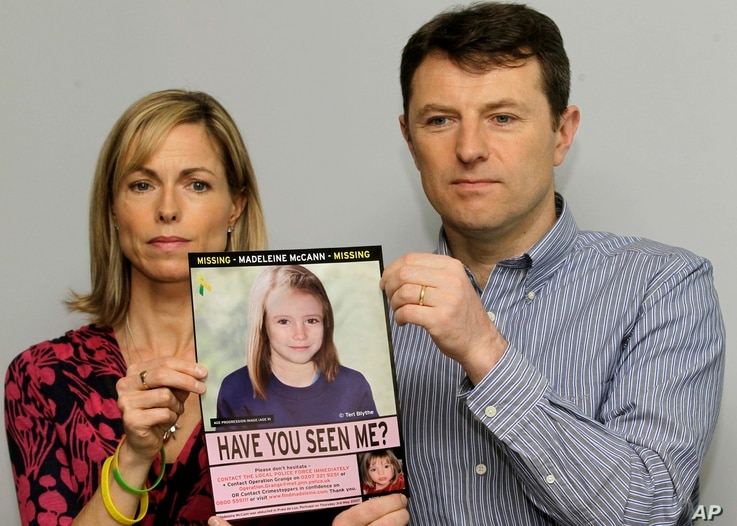 FILE - Kate and Gerry McCann pose with a missing poster, an age progression computer generated image of their daughter Madeleine at 9 years old, as they mark their daughter Madeleine's birthday and the fifth anniversary of her disappearance in London...