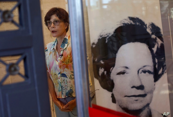 Rosa Cardoso, a lawyer who led Brazil's national truth commission talks, as she stands next to a photo of Lyda Monteiro da Silva, who was the secretary of the Order of Attorneys of Brazil and who was killed while opening a letter bomb addressed for t...
