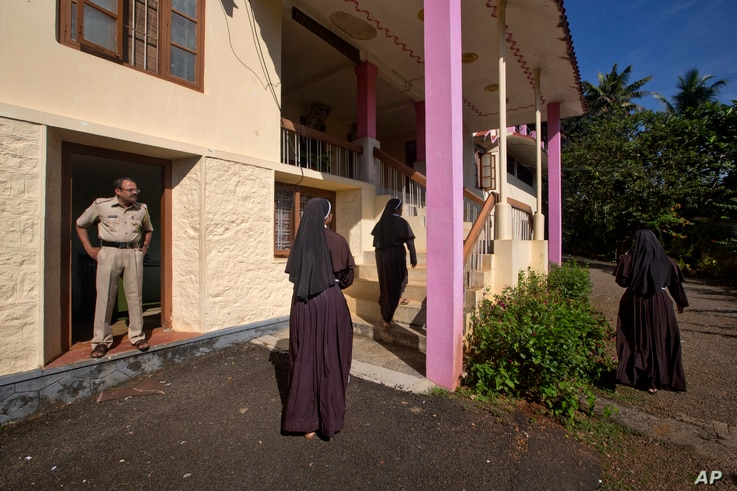 A policeman stands guard as nuns who have supported the accusation of rape against Bishop Franco Mulakkal return from the chapel in St. Francis Mission Home in Kuravilangad in the southern Indian state of Kerala, Nov. 4, 2018.