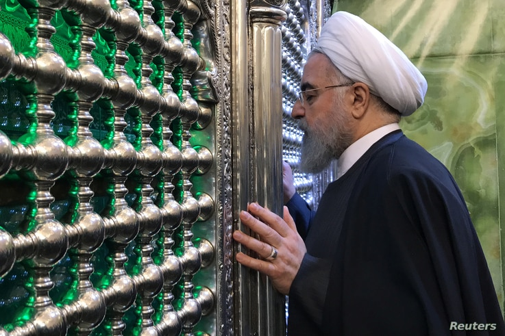 ranian President Hassan Rouhani visits the shrine of Imam Moussa al-Kadhim in Baghdad, Iraq, March 11, 2019.