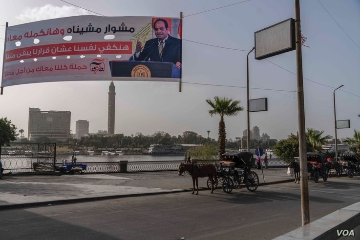 A campaign banner along the Nile urges voters to re-elect Abdel Fattah el-Sissi in next month's elections. Ethiopia embarked on construction of the gigantic dam as Egypt was embroiled in the political turmoil of the 2011 revolution that toppled longt...