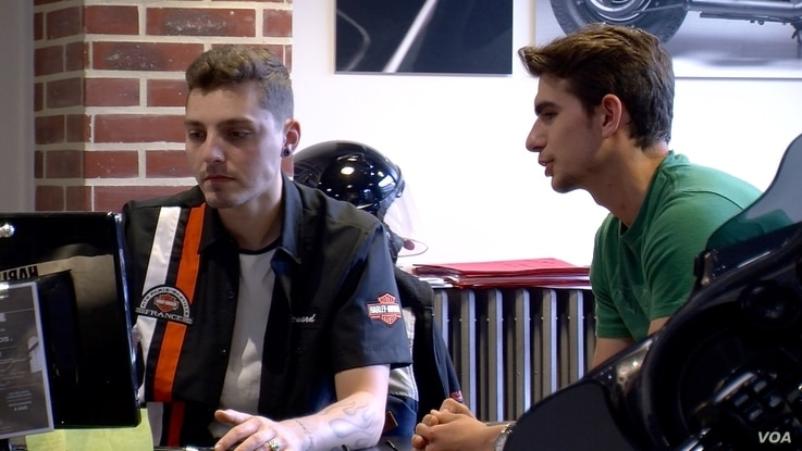 The co-director of Harley's Bastille store says Harley-Davidson is attracting young riders along with older ones. (L. Bryant/VOA)