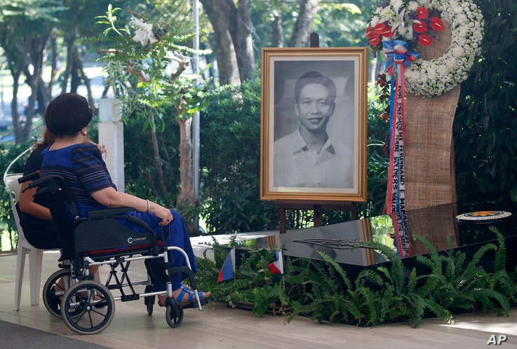 FILE - Former First Lady and now Congresswoman Imelda Marcos and Gov. Imee Marcos of northern Ilocos Norte province visit the gravesite of her late husband, former dictator Ferdinand Marcos at the Heroes Cemetery in observance of National Heroes Day,...