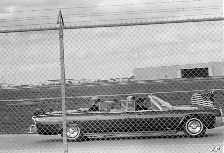 President John F. Kennedy's limousine heads for Air Force One at Brooks Air Force Base in San Antonio, Texas, Nov. 21, 1963.