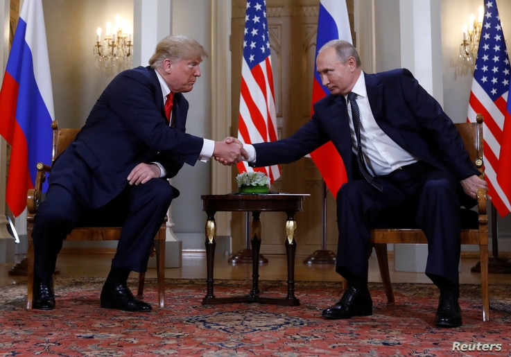 U.S. President Donald Trump and Russia's President Vladimir Putin shake hands as they meet in Helsinki, Finland, July 16, 2018.