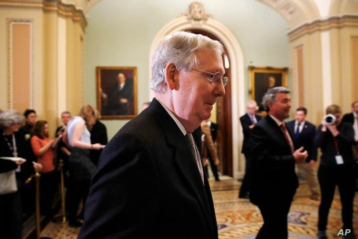 Senate Majority Leader Mitch McConnell of Kentucky leaves a news conference with Republican leaders, March 20, 2018, on Capitol Hill in Washington.