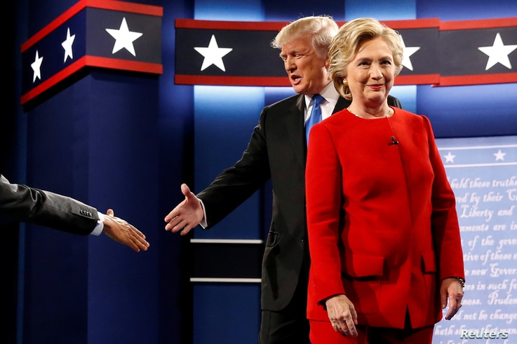 Republican U.S. presidential nominee Donald Trump and Democratic U.S. presidential nominee Hillary Clinton take the stage for their first debate in Hempstead, New York, U.S. September 26, 2016.