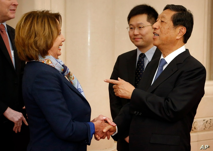 FILE - U.S. House Minority Leader Nancy Pelosi of Calif., left, speaks with with Zhang Ping, vice chairman of China's National People's Congress, as she arrives for a bilateral meeting at the Great Hall of the People in Beijing, Nov. 12, 2015.