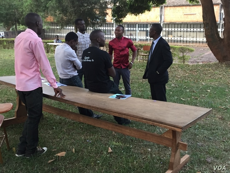 As of 7:30 am there had still been no ballots delivered to this polling station at Makerere University, Feb. 18, 2016. (J. Craig/VOA)