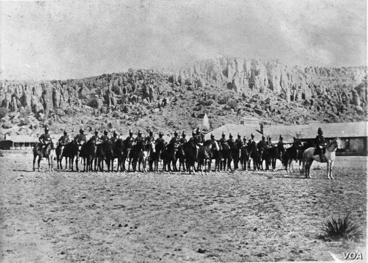 The Ninth Cavalry, the first Buffalo Soldiers to garrison Fort Davis, on parade in 1875.