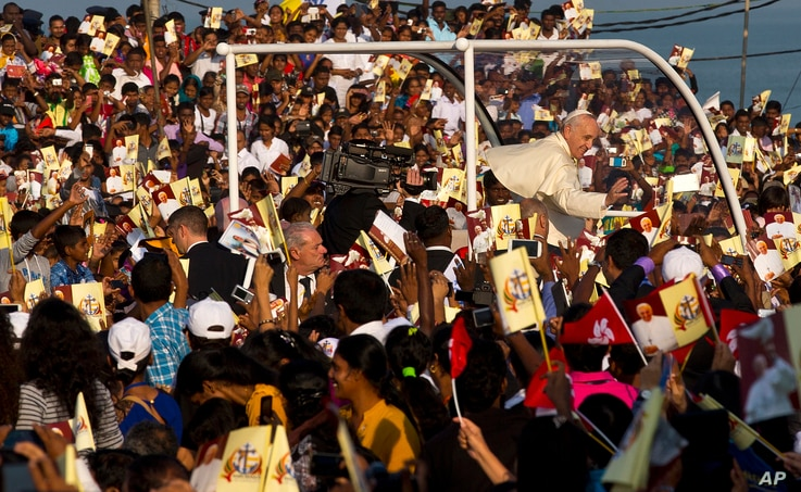 Pope Francis waves to the crowd as he arrives to hold a mass at Colombo's seafront Galle Face Green for the canonization ceremony of Joseph Vaz, Wednesday, Jan. 14, 2015.
