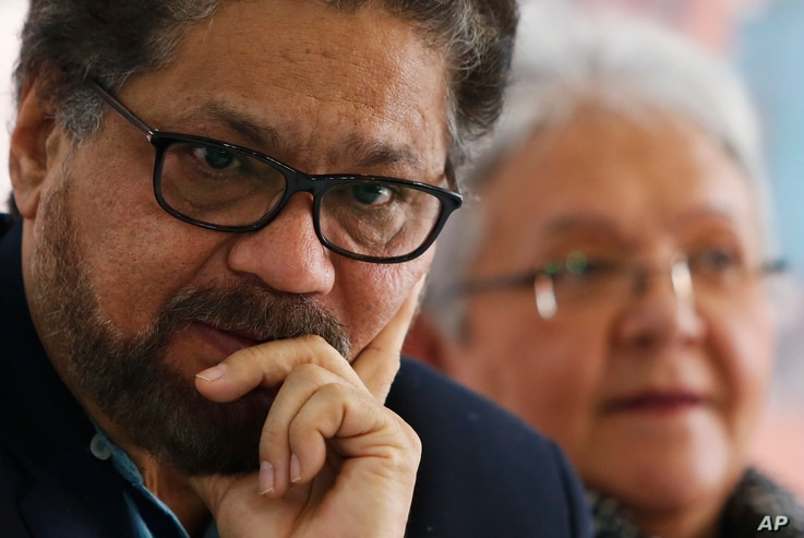 FILE - Ivan Marquez, a former leader of the Revolutionary Armed Forces of Colombia, pauses during a press conference in Bogota, Colombia, March, 8, 2018.