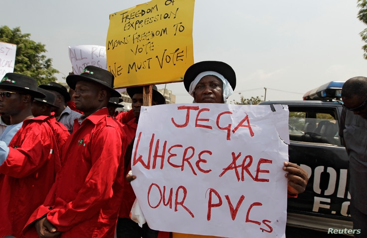 Demonstrators gather at the Independent National Electoral Commission office in Abuja, February 9, 2015.