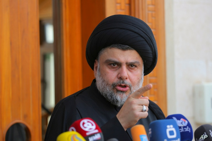 Sh'iite cleric Muqtada al-Sadr speaks during a media conference in Najaf, Iraq,160 kilometers south of Baghdad, April 30, 2016. Hundreds of Sadr's supporters protesting against the government, stormed into the heavily fortified Green Zone in Baghdad