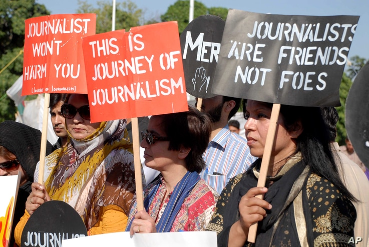FILE - Pakistani journalists are seen rallying in support of their colleague Hamid Mir, who was shot and injured by gunmen in Karachi, April 23, 2014.