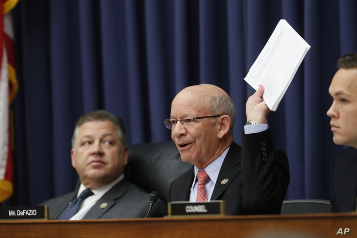 Rep. Peter DeFazio, D-Oregon, ranking member on the House Transportation Committee holds up airlines passenger rules as he questions United Airlines CEO Oscar Munoz during the committee's hearing on Capitol Hill in Washington, May 2, 2017.