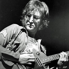 In this Aug. 30, 1972 file photo, John Lennon performs at New York's Madison Square Garden.