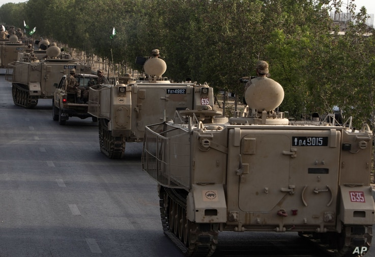 Pakistani army troops ride military vehicles following an operation launched against the Taliban in North Waziristan, in Karachi, Pakistan, Monday, June 16, 2014. Pakistani jets pounded targets in the country's northwest on Monday as the military wag...