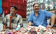 Essam Rashad, left, happily back on his sheesha pipe after a day of abstaining.