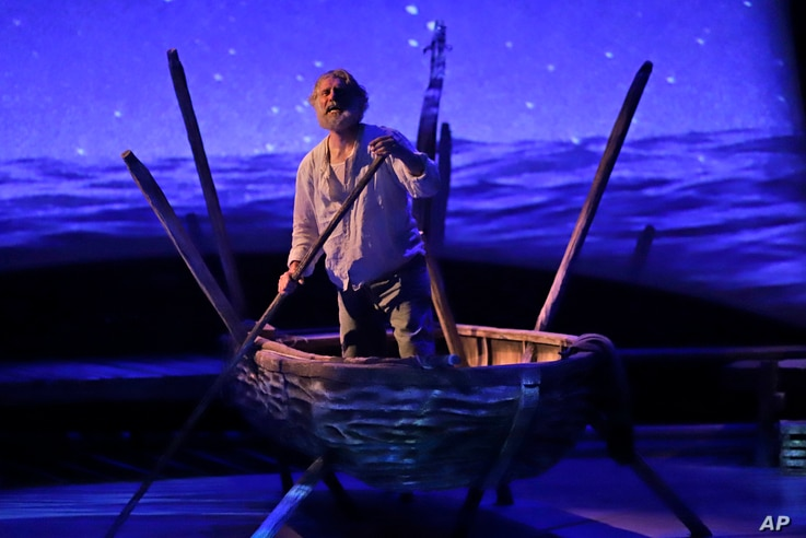 "In this Sunday, Jan. 27, 2019, photo, actor Anthony Crivello plays the role of Santiago in a stage adaptation of Ernest Hemingway's ""The Old Man and the Sea"" during a dress rehearsal at the Pittsburgh Playhouse in Pittsburgh."