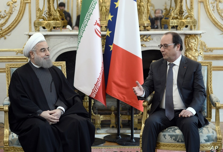 French president Francois Hollande, right,  speaks with Iranian President Hassan Rouhani during a meeting at the Elysee Palace, in Paris, Jan. 28, 2016.