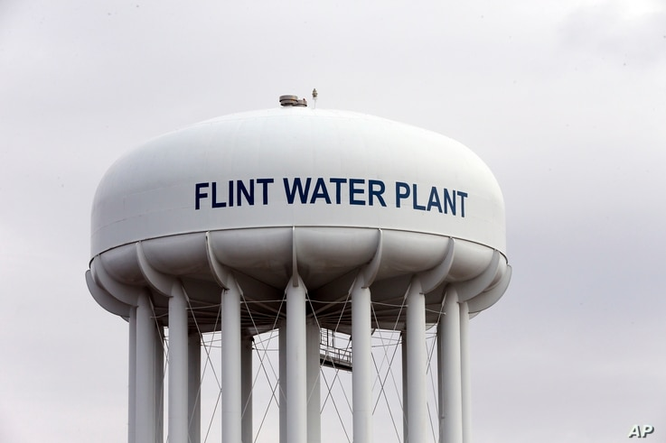 The Flint, Mich.,water tower is seen in this Feb. 5, 2016 photo.  Flint is under a public health emergency after its drinking water became tainted when the city switched from the Detroit system and began drawing from the Flint River in 2014 to save m