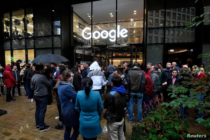 Workers stand outside the Google offices after walking out as part of a global protest over workplace issues, in London, Britain, Nov. 1, 2018.