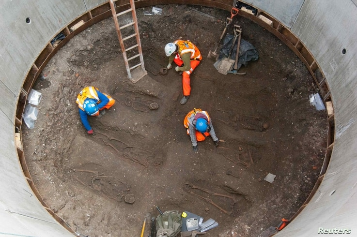 Archaeologists work on unearthed skeletons in the Farringdon area of London in this undated handout photograph released March 15, 2013.
