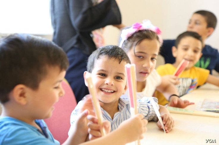 Children do some coloring at the Selam Orphanage. (M. Qarra)