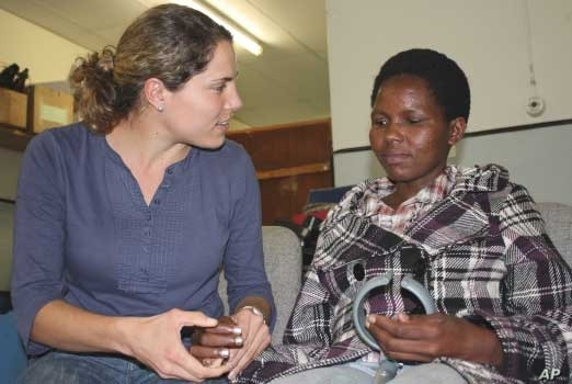 Nokuzola Ndabazonke (right) has survived a stroke, HIV and TB meningitis in Oliver Tambo District, South Africa, largely thanks to her physiotherapist, Laura Grobicki