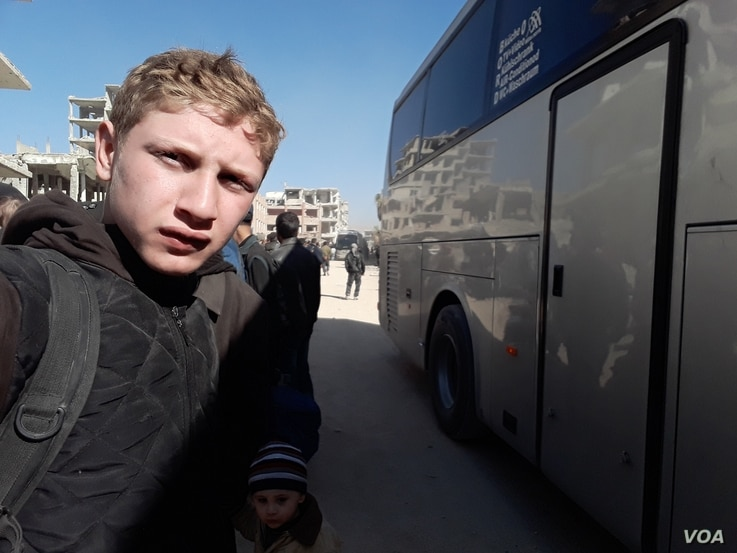 Muhammed Najem takes a selfie before evacuating from Eastern Ghouta to Idlib, March 26, 2018.