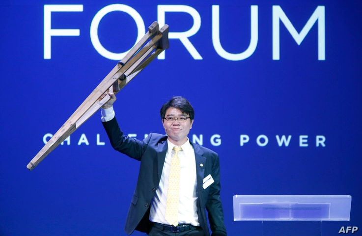 FILE - Ji Seong-ho, president of Now Action & Unity for Human Rights, holds up crutches at the Oslo Freedom Forum, May 26, 2015.